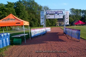 The feel of running through a professional looking finish line with sponsorship banners flying in the air. Banners and signage for race sponsors is always a big part of any race event or racing marathon. Race directors take note. Always buy is you can afford it.