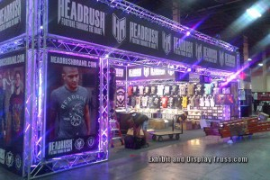 Large vendor or merchandising booth for Head Rush brand at the UFC Fan appreciation Day.