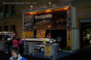 Boatguide trade show display made with aluminum trussing. Fantastic tall exhibit that stands out in a crowd. Boatguide aluminum truss convention hall display booth.