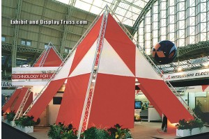 Creating designs and uncommon shapes always make for an exciting trade show display booth at any convention hall of exhibition center. This triangle shaped trade show display booth makes a huge impact at this show.